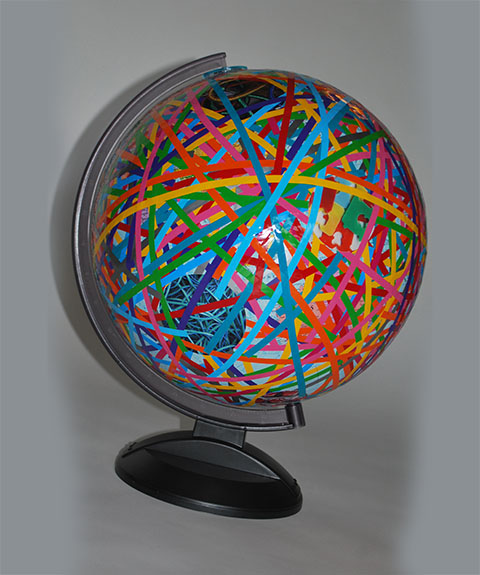 "Spinning globe, vinyl color stripes & prints / 20"" diam x 25"" tall (aprox) /2009 /"